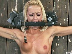 If you're into BDSM then you're gonna love this one as we have the blonde Breanne Benson getting a forced orgasm as she's completely incapable of moving.