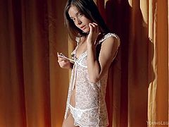 Guerlain is a dark haired skinny teen brunette that strips out of her white lace lingerie in a tempting manner in the bedroom. Leggy girl bares her perky tits playfully. Shes so sexy!