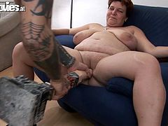 Busty fat granny Renate Zug pleases some tattooed man with a blowjob. Then she lets him drill her snatch with a toy and destroys the guy's ass with a strap on.