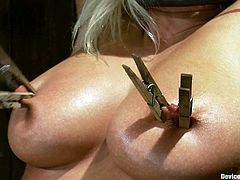 Kait Snow is the big breasted blonde featured in this bondage BDSM porn video where she gets nipple tortured.