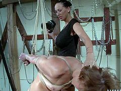 Chubby blonde babe Szilvia with natural boobies gets tied up by heavy chested brunette with ponytail in black dress. Mature bitch is taking photos during rough fantasy from different angles.