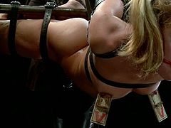 This busty and naughty blond babe is so fucking painsult lover. She gets on that bar and he tits her up to give her some amazing pain.
