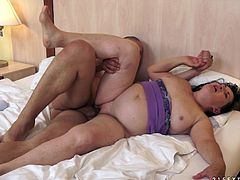 A big and ugly granny has her fat vag vibrated by a younger guy before having it hammered like crazy.