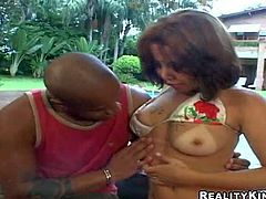 sexy Nicole with tan lines spreads her legs and gets her muff tongue fucked by dark skinned guy after she loses her bikini by the pool Watch her get her bushy sexy pussy eaten out.