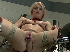 Slender blonde girl in stockings gets tied up and gagged. After that she gets her vagina fisted and mouth fucked. Then she also gets fucked in her vagina.