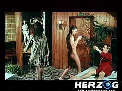 In this classic porn a guy is getting a massage while another guy jacks off in another room in preparation to fuck hairy pussy. In a hot tub a man make out with his sexy wife and invites another lady to join the mix.