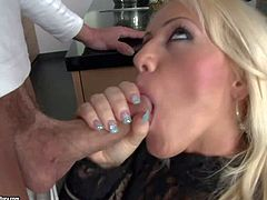 Stunning blonde milf with big juicy gazongas in sexy outfit and high heels gets her ass licked by her randy lover and fucks with him like crazy in the kitchen