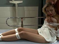 Beautiful blonde nurse gets tied up by the patient. After that he fucks this babe in her mouth and pussy. She also gets fingered and hit by electricity.