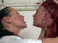 Barefoot redhead Angelina Blue in short red dress and white thong panties gets tied up and used by mistress Mandy Bright. Brunette touches and slaps her nice butt cheeks over and over again.