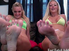 Imagine being able to serve two goddesses like us?  We'll make yoy our foot bitch in no time.  You'd be on your knees in a second begging to suck our toes and massage our feet.  Look at how sexy our feet