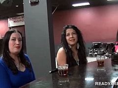Two tempting brunettes dared to fuck for loads of cash in a bar