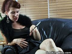 Mistress Mina is kind of Bitchy today,but looking hot in a fur stole and high heels in this solo video.Watch her smoking from long black holder and she shows her big tits and sexy pussy.