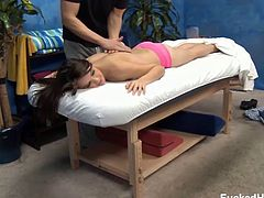Young brunette cutie Jeslene lays on the massage table waiting for her free massage and isn't surprised at how good it feels, well just wait till his hands work their magic on her pussy.