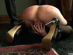 Check out this sex slave rubbing her sweet pussy again and again while her master performs painful actions on her. Don't miss this BDSM video!