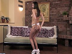 Pretty brunette Kitty Jane takes her clothes off and shows her nice body. Then she sits down on a sofa and entertains herself by fucking her snatch with a dildo.