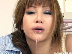 This naughty and lusty Japanese hottie is all about blowjob really. She ets down on that hard cock and starts sucking it with passion.