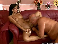Exotic tanned black haired Kyra Black with fit body and natural hooters gets licked by bald chubby grandpa and rides on his stiff pecker like crazy on red leather couch