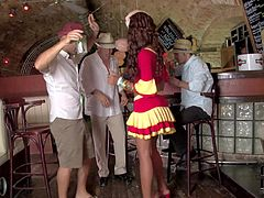 Katia D Lys is one flirty sexy waitress from Cuba. Sexy dressed leggy tan skin brunette flashes her panties and turns guys on at a bar. She finds herself getting used by three guys and loves.