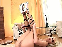 Pretty hot and young horny babe Blue Angel is lying on the floor and fucking her puss with the vase, she is bending in rather poses and stuffing it deeper!