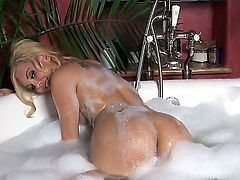 Sweet and horny blonde porn star Aaliyah Love plays with her pussy in the bath tub