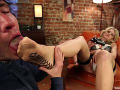 Get a load of this blonde's amazing body in this feet worshiping scene where she's later on fucked silly by the guy worshiping her feet.