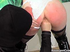 Watch this slutty mature having her hot ass spanked by a guy wearing a ski mask before fingering her wet pussies.