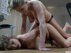 Two stunning blonde chicks have an amazing lesbian sex in the gym. They lick and toy each others pussies. After that they fuck one another with the strap-on.
