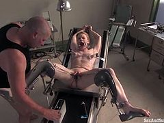 Redhead hottie Madison Young lets salacious Mark Davis tie her up to a gynecological chair. Then Mark pulls the bitch by her pussy lips and makes her suck his dick before he pokes it in her snatch.