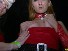 Avril Hall and Vicki Chase get down on their knees in the dark of the night club. Drunk party sluts do it to give head to Santa. Blonde and brunette suck Santas cock and balls in public like theres no tomorrow.