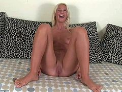 Skinny blonde Evelyne Foxy in blue jeans strips down to her bare skin and demonstrates her neat bare feet, small boobs and shaved pussy before she takes big pink dildo in her love hole in front of the camera.