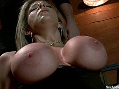 Lecherous blonde milf Sara Jay lets insatiable stud Mark Davis tie her up and put a gag in her mouth. Mark torments Sara and fucks her juicy cunt deep and hard.