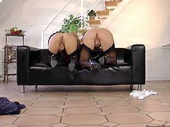 Well, this weird British housewife knows how to spend time properly. Kinky lady and her bootylicious friend pull up skirts and bend over the couch. Just look at their appetizing asses! Spoiled sluts desire to be fucked doggy tough. Don't waste any single minute and polish the wet cunts right away.