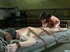 Gorgeous brunette babe gets gagged and chained. She fondles her pussy and then gets her wet pussy drilled. After that she sucks a cock.