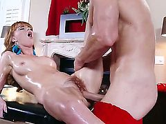 Sweet redhead chick Marie McCray gets her slender body oiled intense by a hot Santa and gets her pussy stimulated with a vibrator. After that he starts to fuck this babe!