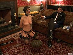 Watch this hot bondage scene where a sexy brunette's tied up and tortured by her master while you take a look at her great body.