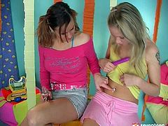 Two lewd teens play with different sex toys before a furious blondie kneels down in front of aroused brunette to tongue fuck her bald pussy.