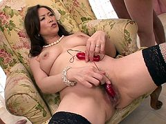 Divine Japanese milf takes off her seductive black lingerie remaining in fishnet stockings before she sits on a chair with legs spread aside and masturbates with fingers, while three aroused dudes jerks off watching on her in steamy gangbang sex video by Jav HD.
