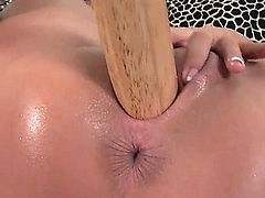 Marvelous babe with amazing fit body Dorina is shoving her favorite things inside of her pussy, be it a baseball bat or a huge dildo toy which Evelyne Foxy gave to her.