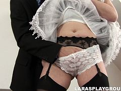 Kinky British mature nympho is far from being really hot or beautiful. But this spoiled pale and tall slut is fond of casual sex. Horny brunette looks like a maid in short black dress and desires to get her pussy tickled on the couch.
