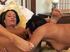 Dark haired experienced glamorous lezzies Ann Marie Rios and Michelle Lay with natural hooters and good looking bodies have spontaneous wet pussy licking action filmed in close up in bedroom.