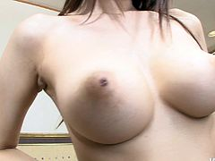 She is adorable Japanese girl wearing tempting silk lingerie. She lies on a couch letting horny man play with her body. Damn, this babe has got gorgeous perfectly rounded big boobs. She blows my mind.