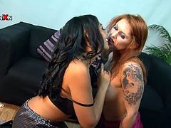 Rio Lee and Tallulah Tease undress and then the redhead girl lies down on a sofa. She gets her wet vagina fisted deep.