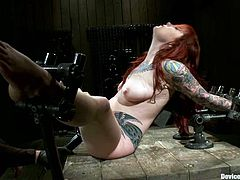 Misti Dawn is the hot redhead babe who's going to go through some crazy stuff in this video where she'll endure extreme bondage, fingering, toying and spanking.