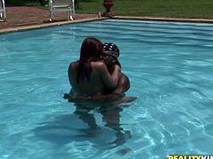 Filthy Latin red-haired hoe sits on a poolside with legs spread aside while welcoming a tongue fuck of her nasty cunt. Later she kneels down to oral fuck massive hard cock of horny black daddy.