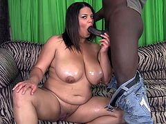 Miss Lady Spyce likes big black dongs more then anything. It doesn't matter if she receives such bbc in her pussy or in her mouth, as long as she's getting what she wants. Lady acts like a whore. Here she is getting those big boobs and her naughty ass groped until she fills her mouth with an ebony cock.