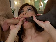 A filthy mature whore enjoys two different dicks here as a black guy and a white guy double team her.