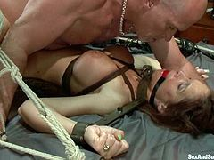 Horny redhead MILF gets slapped and fucked in both holes. She also gives sloppy blowjob. Then she gets tied up and fucked again.