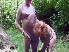 Busty grandma Daniela had too much beer and now she's acting like a slut. Her man grandpa Depa takes her to a walk in the woods where granny gets in touch with nature and his hard cock. Watch Daniela swallowing his saggy cock and enjoying herself, the old whore still knows how to give an awesome head!