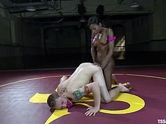 Slender transsexual babe fucks a guy in his ass doggystyle. He also gets his ass spanked and face covered with cum.