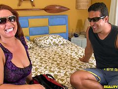 Rapacious curvy Latin milf lies on the bed with legs spread aside while pounding her spoiled shaved cunt with dildo in steamy solo sex scene by Reality Kings.